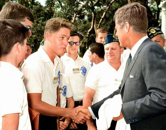 Bill Clinton shaking hands with JFK
