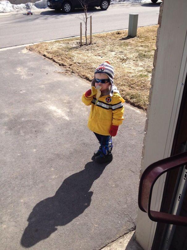 Kid eating banana.