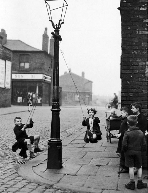 Kids swinging off in the street