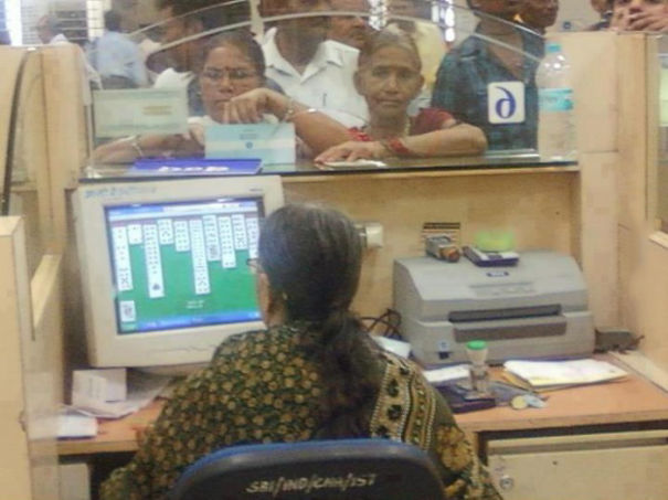 woman clerk playing cards on pc.