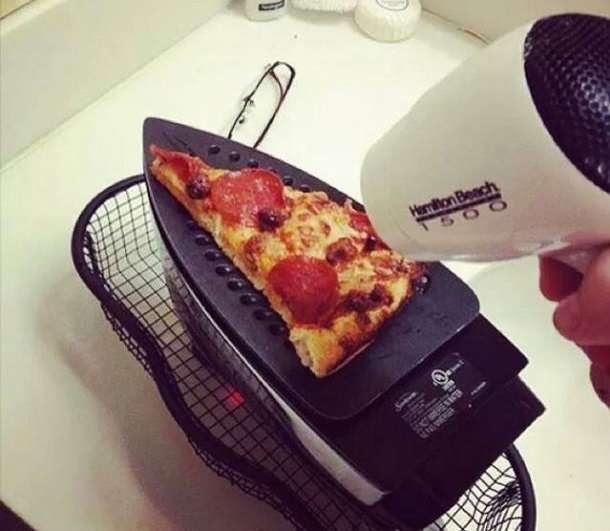 cooking pizza on iron.jpg