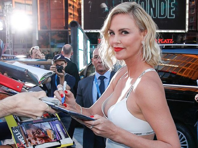 Charlize Theron giving autograph to their fans