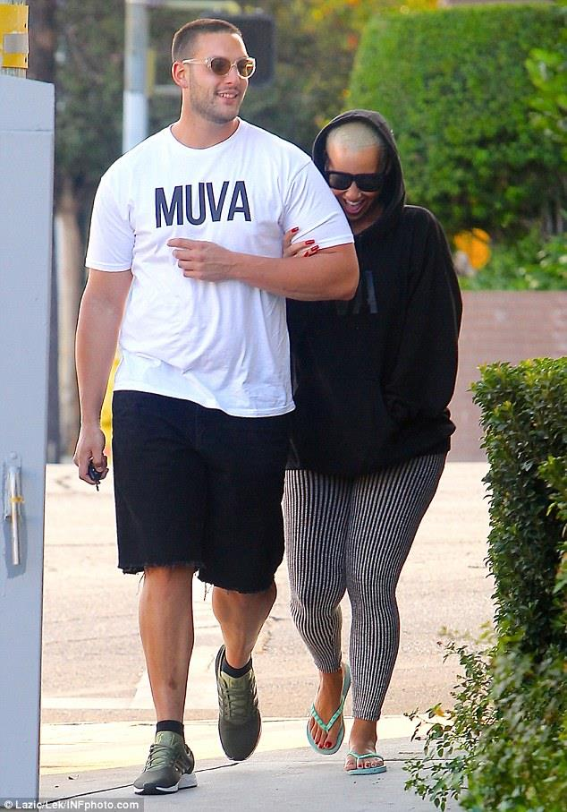 Amber Rose and her bodyguard often get touchy-feely