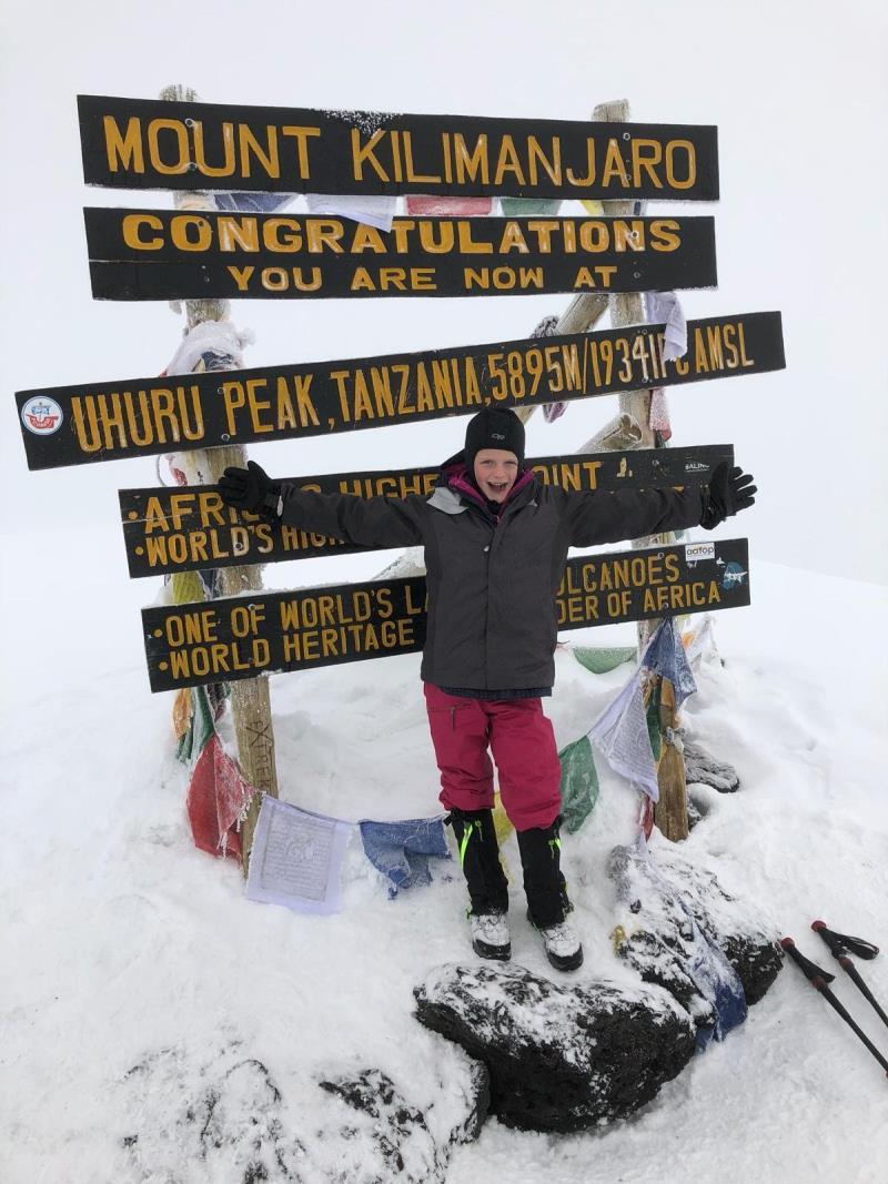 What inspires her to climb mountain Kilimanjaro?